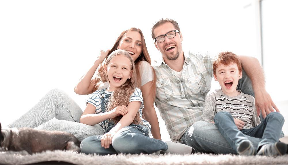 family of four smiling l dentist 30080