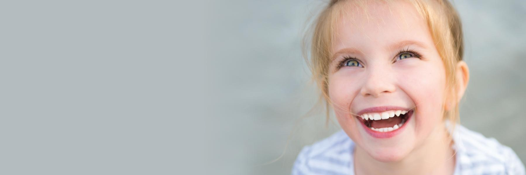 Young child smiling l family dentistry smyrna ga